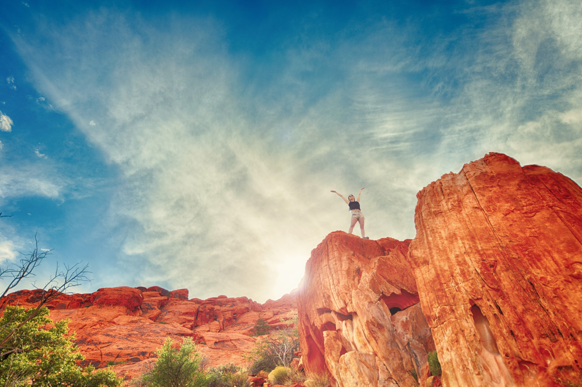 Girl on red rock desert cliff BioSuperfood