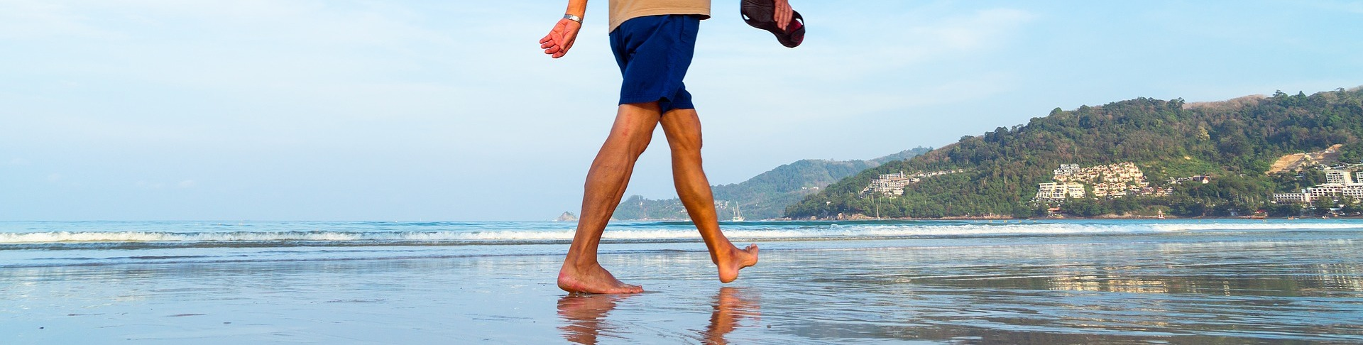 Man walking on beach. BioSuperfood promotes healthy aging and longevity